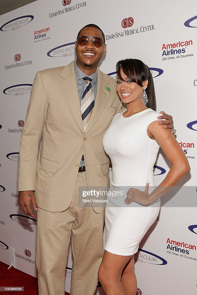 Carmelo Anthony (L) and La La Vazquez attend the 25th anniversary of Cedars-Sinai Sports Spectacular Hyatt Regency Century Plaza on May 23, 2010 in Century City, California.
