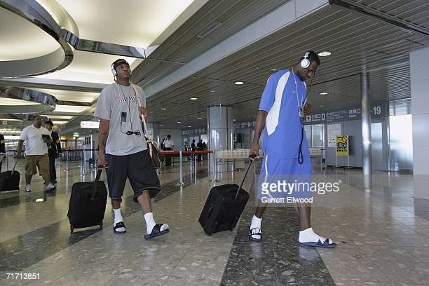 Carmelo Anthony and LaBron James of the USA Basketball Senior Men's National Team arrive at Tokyo International Airport for the FIBA World Basketball...