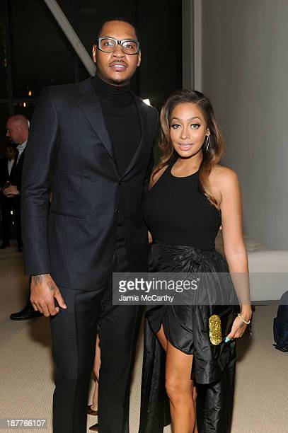 Carmelo Anthony and Lala Anthony attend CFDA and Vogue 2013 Fashion Fund Finalists Celebration at Spring Studios on November 11 2013 in New York City