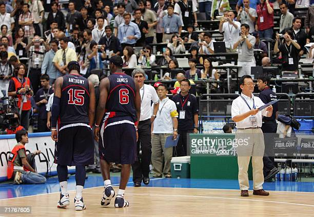 Carmelo Anthony and LeBron James of the USA Basketball Men's Senior National Team walk off the court after losing to Greece during the FIBA World...