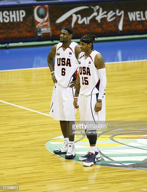 Carmelo Anthony and LeBron James of the USA Basketball Senior Men's National Team stand on the court against Senegal during the preliminary round of...