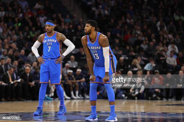 Carmelo Anthony and Paul George of the Oklahoma City Thunder stand on the court during the game against the Minnesota Timberwolves on January 10 2018...