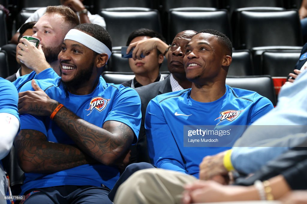 Carmelo Anthony #7 and Russell Westbrook #0 of the Oklahoma City Thunder looks on during the game against the New Orleans Pelicans during a preseason game on October 6, 2017 at Chesapeake Energy Arena in Oklahoma City, Oklahoma.