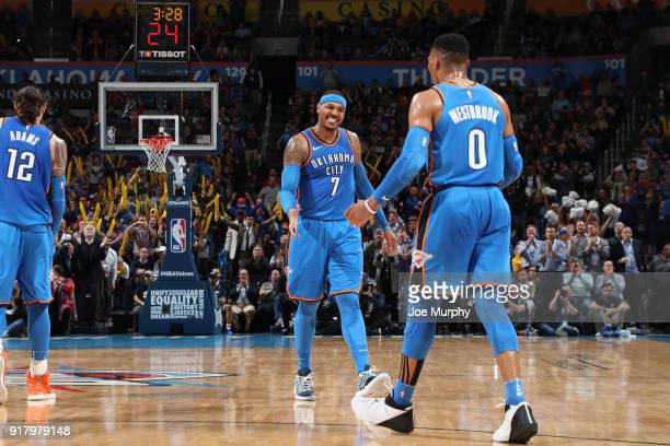 Carmelo Anthony and Russell Westbrook of the Oklahoma City Thunder react to a play during the game against the Cleveland Cavaliers on February 13...