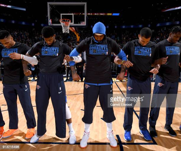 Carmelo Anthony and the Oklahoma City Thunder honor the National Anthem before the game against the Denver Nuggets on February 1 2018 at the Pepsi...