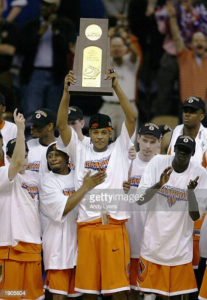 Carmelo Anthony and the rest of the Syracuse team celebrate with the championship trophy after defeating Kansas 8178 during the championship game of...