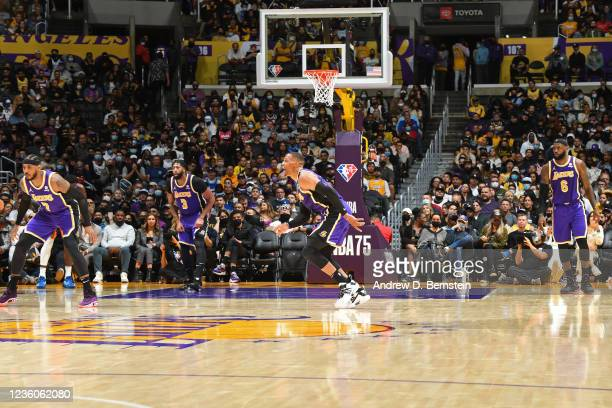 Carmelo Anthony, Anthony Davis, Russell Westbrook an LeBron James of the Los Angeles Lakers stand on the court against the Phoenix Suns on October...
