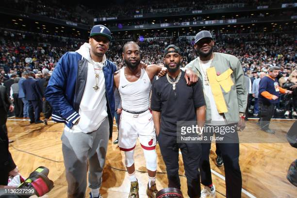 Carmelo Anthony Dwyane Wade of the Miami Heat Chris Paul of the Houston Rockets and LeBron James of the Los Angeles Lakers pose for a photo after...