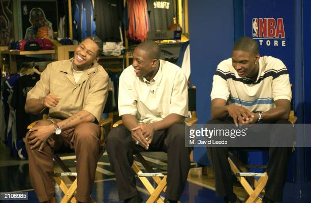 Carmelo Anthony from Syracuse Dwyane Wade from Marquette and Chris Bosh from Georgia Tech share a laugh during an appearance at the NBA Store on June...