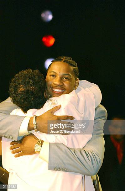 Carmelo Anthony from Syracuse hugs his mother Mary as he is selected overall in the first round by the Denver Nuggets during the 2003 NBA Draft at...