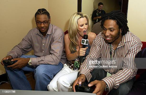 Carmelo Anthony Jenny Mcarthy and Larry Fitzgerald try out an Xbox title at Xbox's E3 press briefing at the Shrine Auditorium Monday May 10 2004