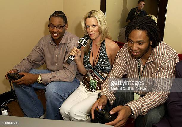 Carmelo Anthony Jenny Mcarthy and Larry Fitzgerald try out an Xbox title during Xbox's E3 press briefing at the Shrine Auditorium Monday May 10 2004