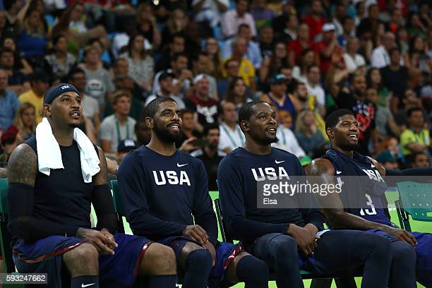 Carmelo Anthony, Kyrie Irving, Kevin Durant and Paul George of the United States look on from the bench during the Men's Gold medal game against...