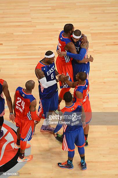 Carmelo Anthony LeBron James and Kyrie Irving of the Eastern Conference AllStars shake hands with Kevin Durant Chris Paul and Kobe Bryant of the...