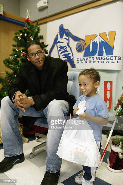 Carmelo Anthony of Denver Nuggets enjoys his visit as he hands out gifts to children at the Family Resource Center on December 15 2003 in Aurora...