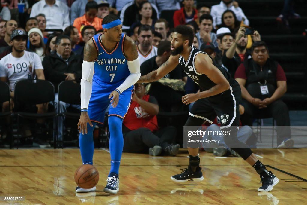 Carmelo Anthony (L) of Oklahoma City Thunder in action against Allen Crabbe (R) of Brooklyn Nets during a NBA regular season game between Brooklyn Nets and Oklahoma Thunder at Mexico City Arena in Mexico City, Mexico on December 7, 2017.