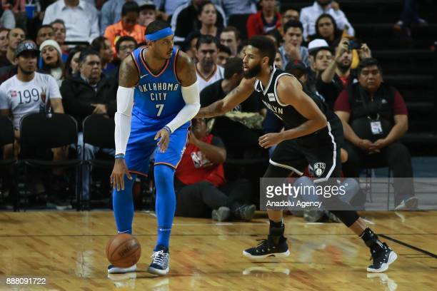Carmelo Anthony of Oklahoma City Thunder in action against Allen Crabbe of Brooklyn Nets during a NBA regular season game between Brooklyn Nets and...