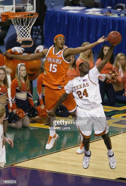 Carmelo Anthony of Syracuse battles Royal Ivey of Texas for a rebound during the semifinal round of the NCAA Final Four Tournament against Texas on...