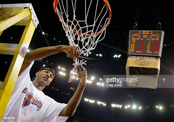 Carmelo Anthony of Syracuse cuts down the net after he and his team defeated Kansas 8178 during the championship game of the NCAA Men's Final Four...