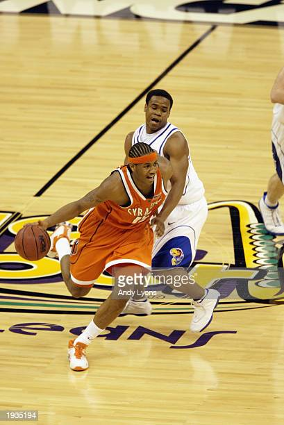Carmelo Anthony of Syracuse dribbles around Michael Lee of Kansas during the championship game of the NCAA Men's Final Four Tournament on April 7,...
