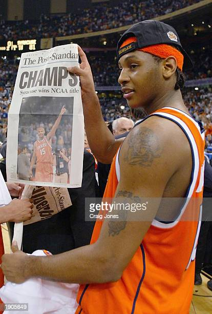 Carmelo Anthony of Syracuse holds up tommorows paper which declares the Orangeman national champs after he and his team defeated Kansas 81-78 during...