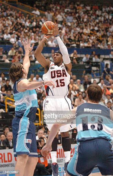 Carmelo Anthony of Team USA shoots over the hand of Argentine Luis Scola during the Bronze Medal game at the FIBA World Championship 2006 at the...