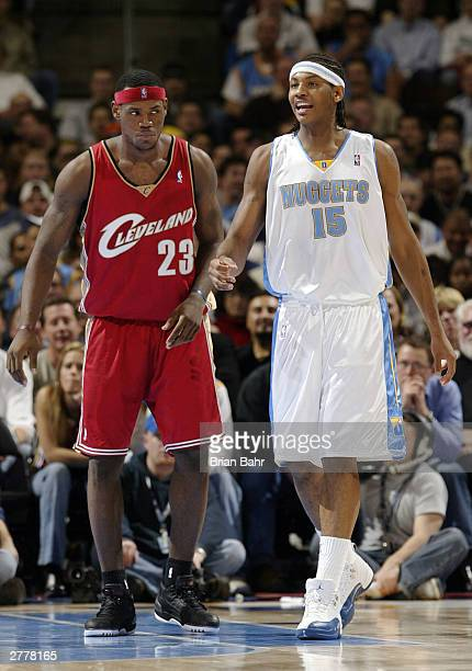Carmelo Anthony of the Denver Nuggets and LeBron James of the Clevelenad Cavaliers cover each other during the fourth quarter December 2 2003 at the...