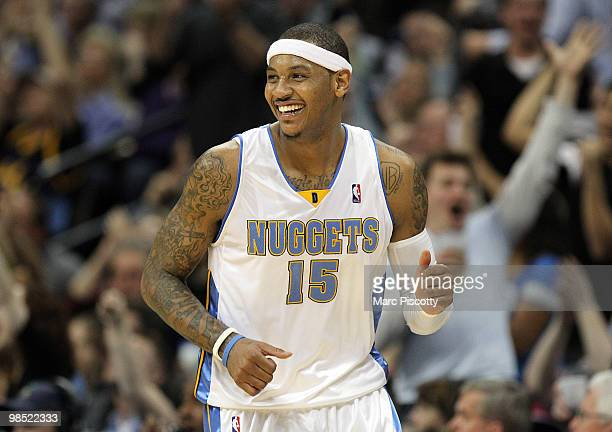 Carmelo Anthony of the Denver Nuggets celebrates after sinking a shot against the Utah Jazz during the second half of Game One of the Western...