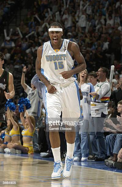 Carmelo Anthony of the Denver Nuggets celebrates hitting a three point shot against the Minnesota Timberwolves in Game three of the Western...