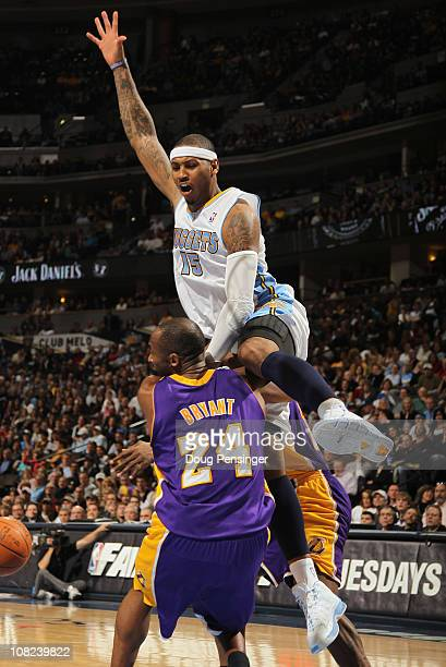 Carmelo Anthony of the Denver Nuggets collides with Kobe Bryant of the Los Angeles Lakers at the Pepsi Center on January 21 2011 in Denver Colorado...