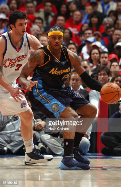 Carmelo Anthony of the Denver Nuggets dribbles against Vladimir Radmanovic of the Los Angeles Clippers in game one of the Western Conference...