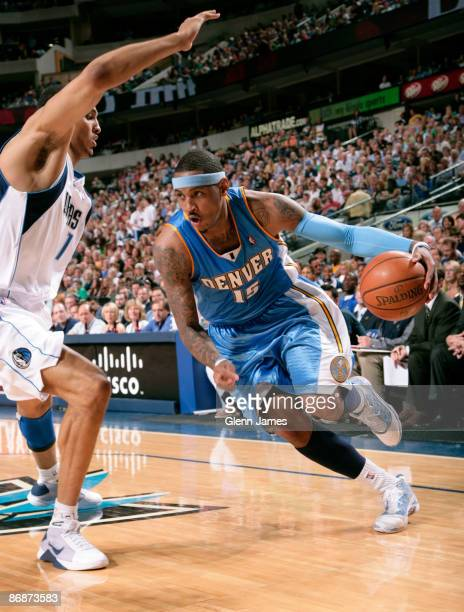 Carmelo Anthony of the Denver Nuggets drives against Ryan Hollins of the Dallas Mavericks in Game Three of the Western Conference Semifinals during...
