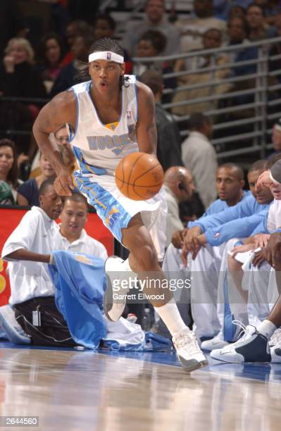 Carmelo Anthony of the Denver Nuggets drives against the Indiana Pacers on October 24 2003 at the Pepsi Center in Denver Colorado NOTE TO USER User...