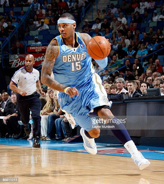 Carmelo Anthony of the Denver Nuggets drives against the New Orleans Hornets on March 25 2009 at the New Orleans Arena in New Orleans Louisiana NOTE...