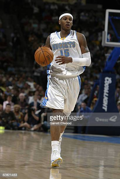 Carmelo Anthony of the Denver Nuggets drives against the Portland Trail Blazers during the game on April 19 2005 at the Pepsi Center in Denver...
