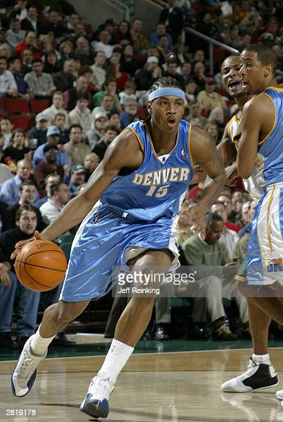 Carmelo Anthony of the Denver Nuggets drives against the Seattle SuperSonics on December 17 2003 at Key Arena in Seattle Washington NOTE TO USER User...