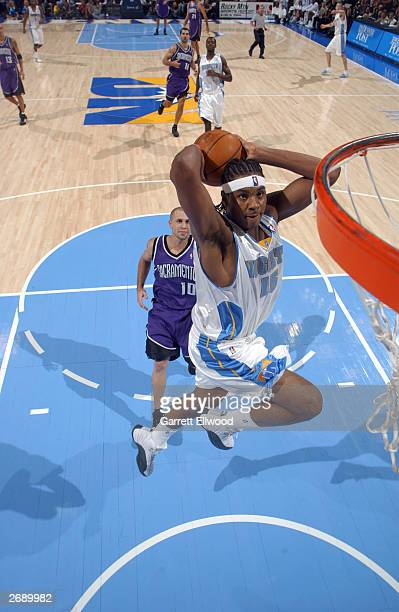 Carmelo Anthony of the Denver Nuggets drives for a dunk against the Sacramento Kings November 1 2003 at the Pepsi Center in Denver Colorado NOTE TO...