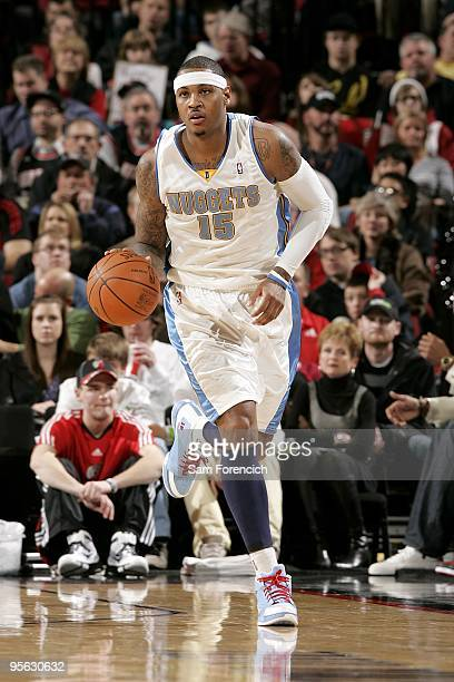 Carmelo Anthony of the Denver Nuggets drives the ball up court during the game against the Portland Trail Blazers on December 25 2009 at the Rose...