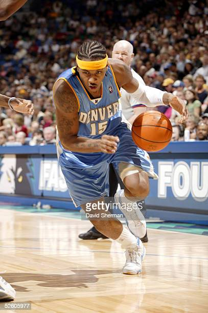 Carmelo Anthony of the Denver Nuggets drives to the basket against the Minnesota Timberwolves on April 8 2005 at the Target Center in Minneapolis...