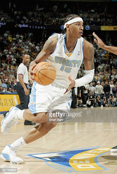 Carmelo Anthony of the Denver Nuggets drives to the net against the San Antonio Spurs in Game four of the Western Conference Quarterfinals during the...