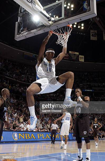 Carmelo Anthony of the Denver Nuggets dunks against the Minnesota Timberwolves in Game three of the Western Conference Quarterfinals during the 2004...