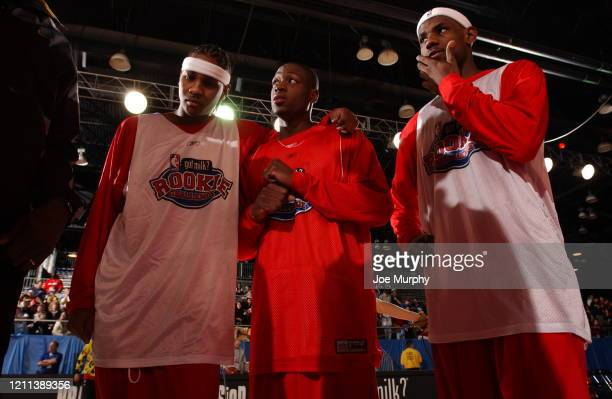 Carmelo Anthony of the Denver Nuggets, Dwayne Wade of the Miami Heat, and LeBron James of the Cleveland Cavaliers look on during the Rookie Team...
