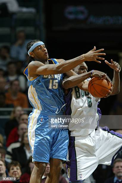 Carmelo Anthony of the Denver Nuggets fouls Joe Smith of the Milwaukee Bucks while battling for a loose ball during the game on March 12 2004 at the...