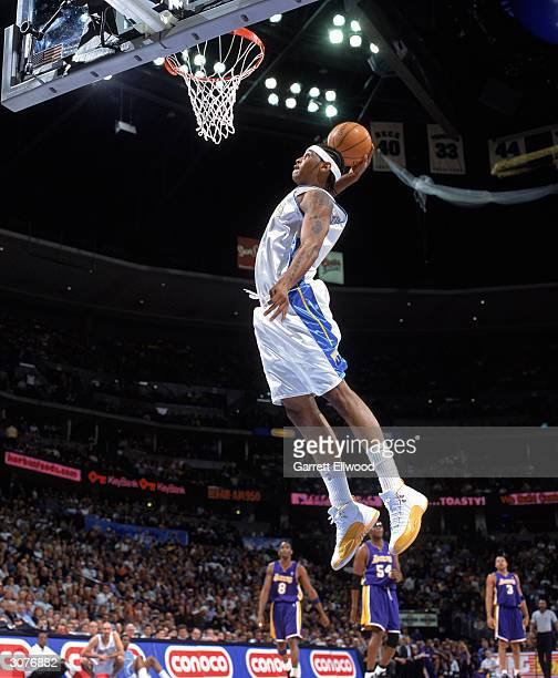 Carmelo Anthony of the Denver Nuggets goes for a slam dunk during the game against the Los Angeles Lakers at Pepsi Center on February 25 2004 in...