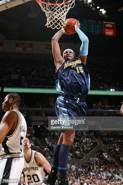 Carmelo Anthony of the Denver Nuggets goes to the basket against the San Antonio Spurs in Game One of the Western Conference Quarterfinals during the...