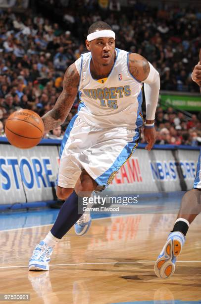 Carmelo Anthony of the Denver Nuggets goes to the basket against the Portland Trail Blazers on March 7 2010 at the Pepsi Center in Denver Colorado...