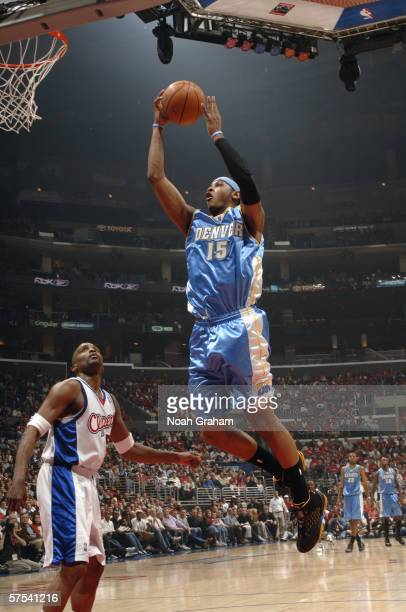 Carmelo Anthony of the Denver Nuggets goes to the hoop over Cuttino Mobley of the Los Angeles Clippers in game five of the Western Conference...