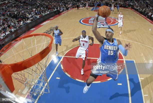 Carmelo Anthony of the Denver Nuggets goes up for a break away shot past Ben Wallace of the Detroit Pistons in a game at the Palace of Auburn Hills...