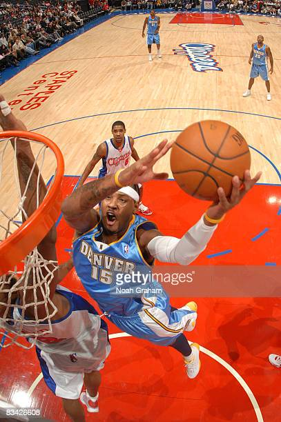 Carmelo Anthony of the Denver Nuggets goes up for a dunk against the Los Angeles Clippers at Staples Center on October 24 2008 in Los Angeles...