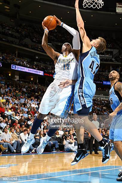 Carmelo Anthony of the Denver Nuggets goes up for a shot against Andrei Kirilenko of the Utah Jazz during the game at Pepsi Center on October 28 2009...